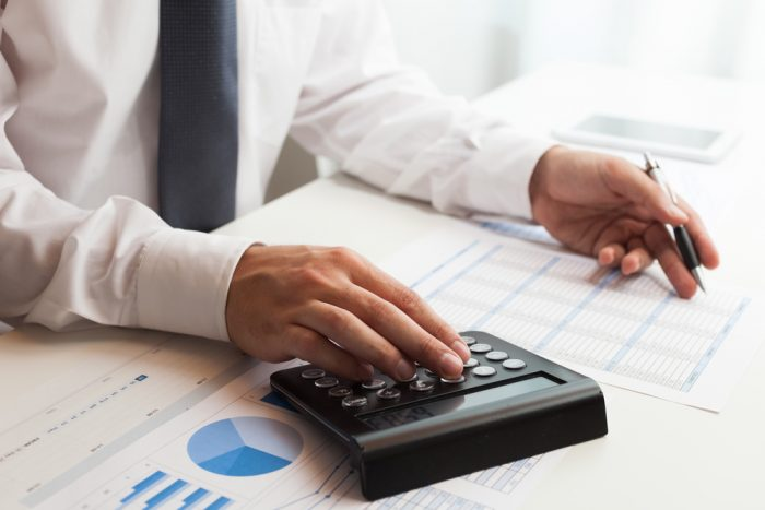 tax responsibilities | picture of accountant reviewing numbers
